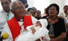 Archbishop-Winston-Halapua-holding-Robert-Sullivan-the-first-baby-to-be-baptised-in-the-refurbished-church_photoDisplay